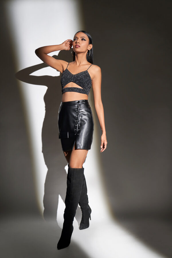 Black shimmer cut out top with faux leather short skirt