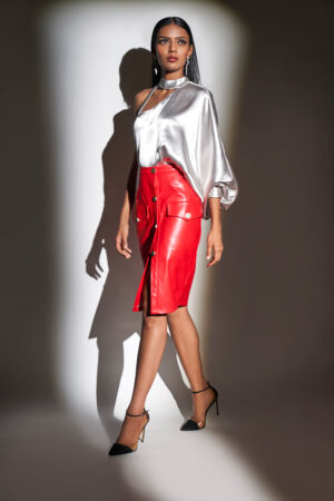Ivory and red one shoulder raglan sleeve top with faux leather skirt